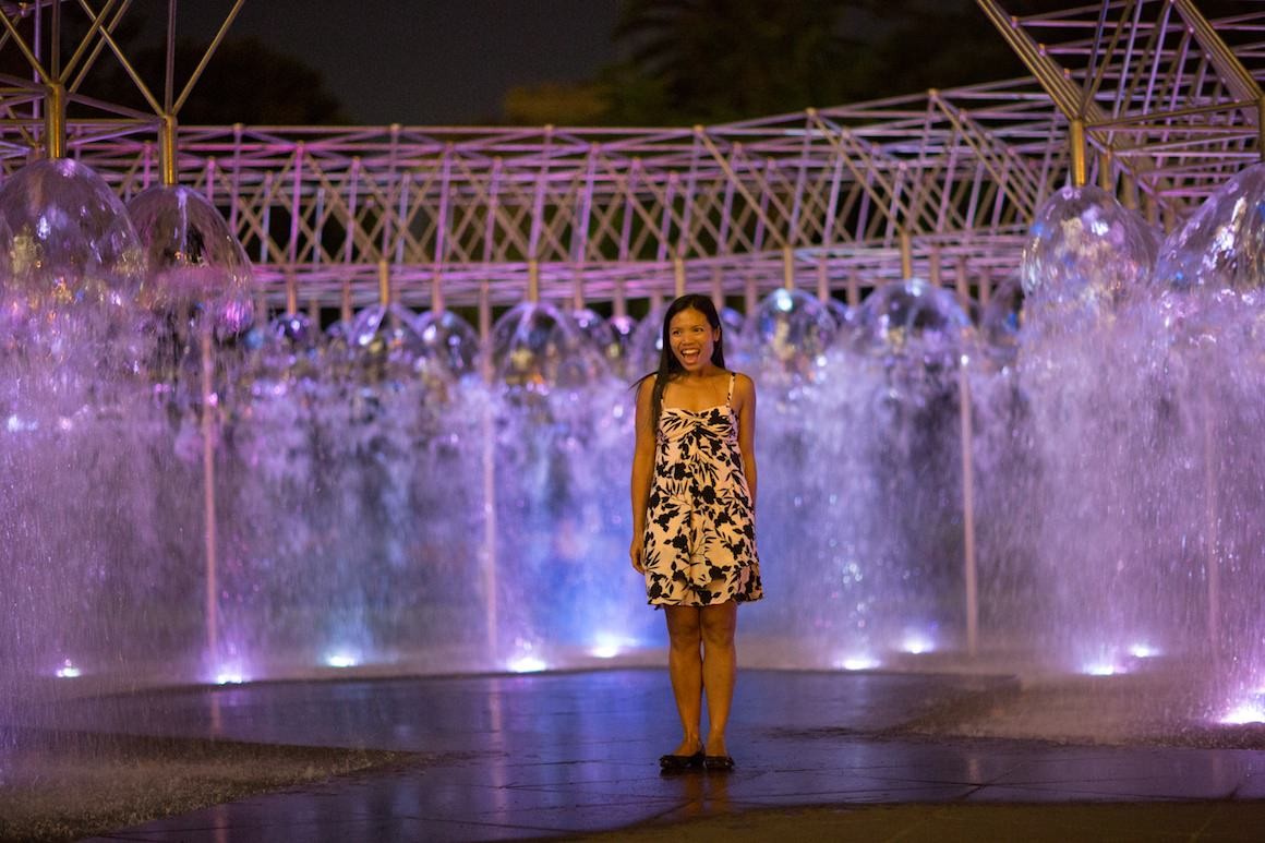 spring street fountain at night - girl