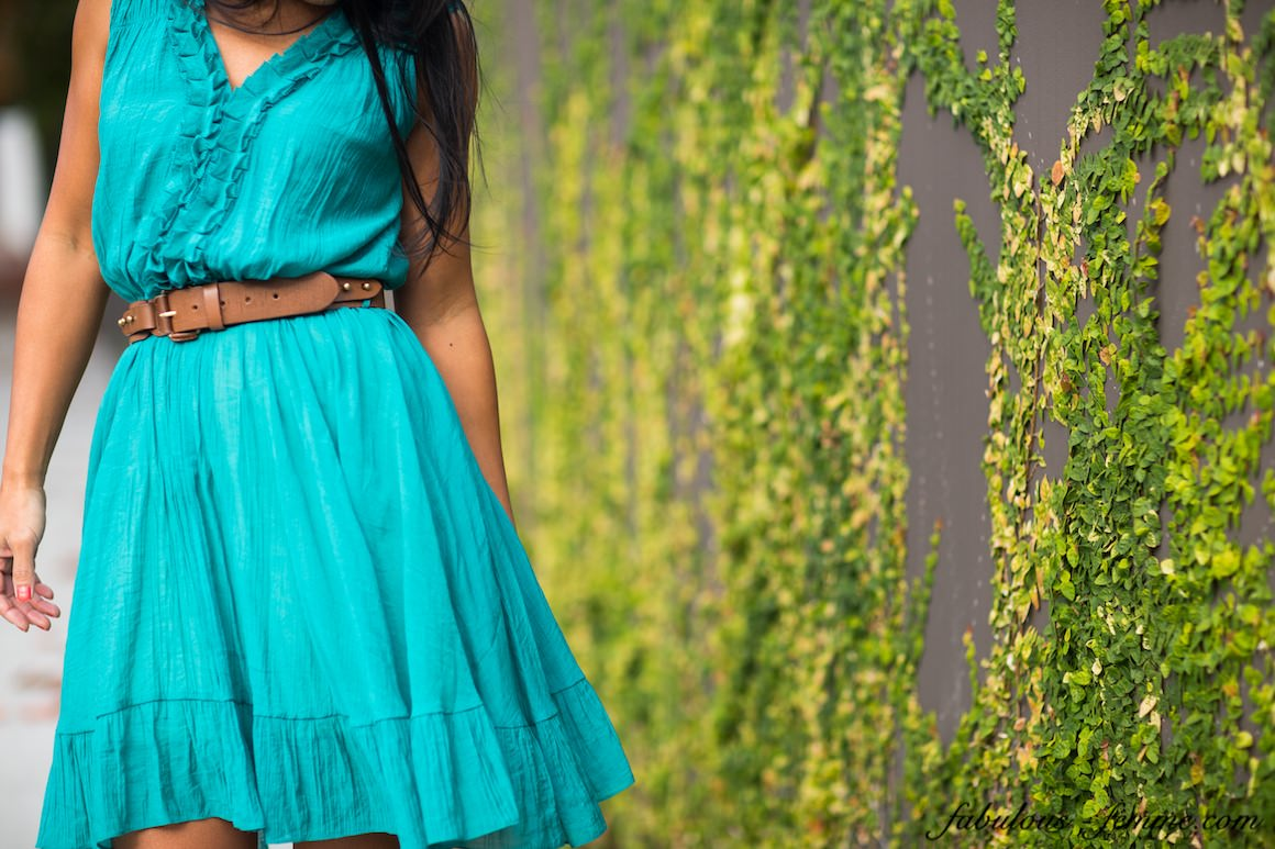 girl in front of wall in teal blue dress - skirt