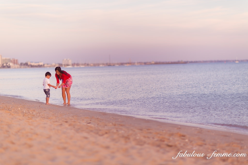 mother with kid at beach in Melbourne