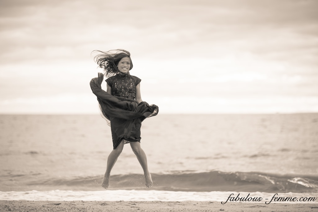 girl jumps on beach in dress - fashion blog melbourne
