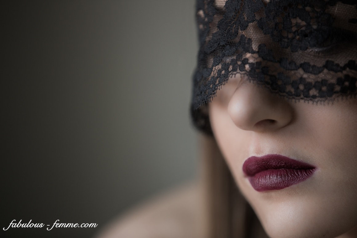 female portrait with lace mask and red lipstick