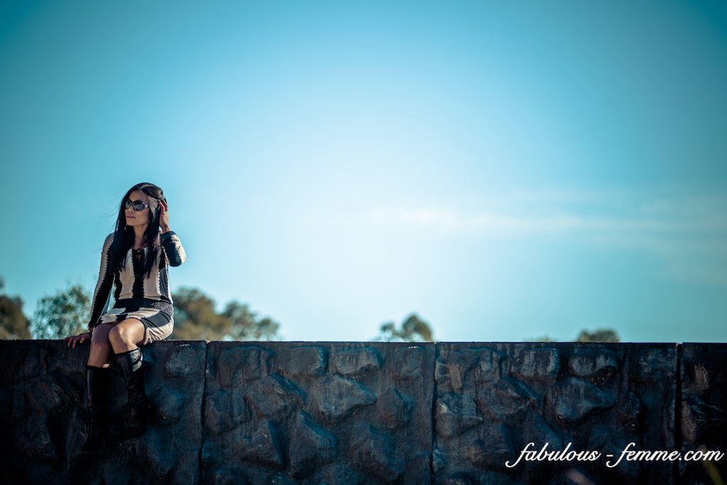 sitting on edge wall - fashion blogger in dangerous situation - silly