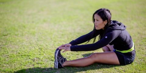 girl performing hamstring stretch