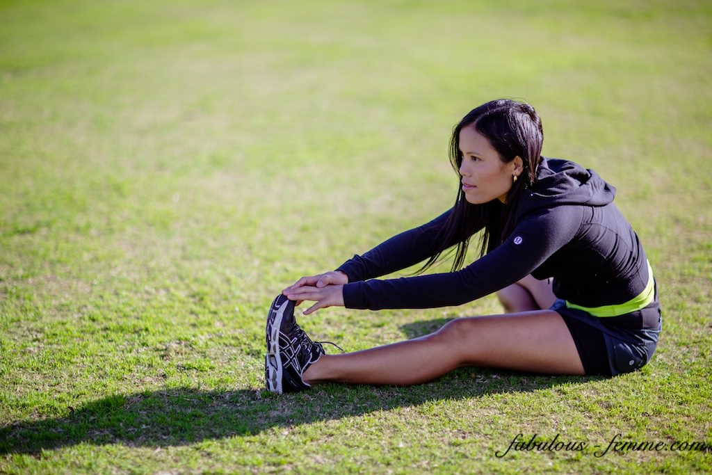 girl performing hamstring stretch