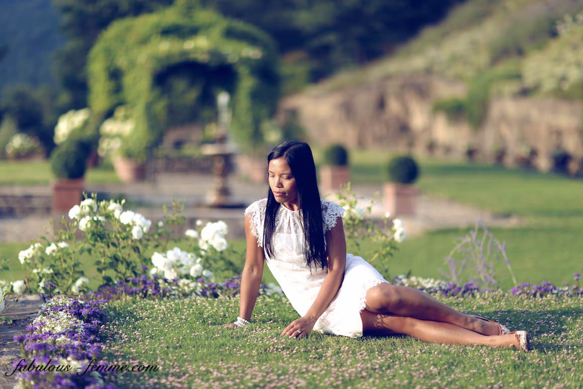 girl on grass in garden of luxury wine resort