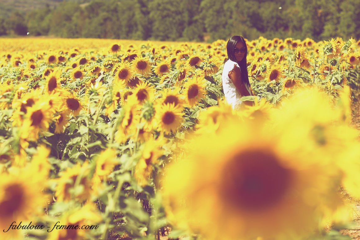 asian girl in sunflower field in italy tuscany - close to florence