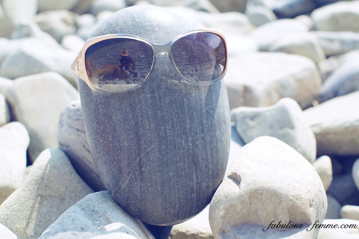 sunglasses on stone - creative photos - hot rock