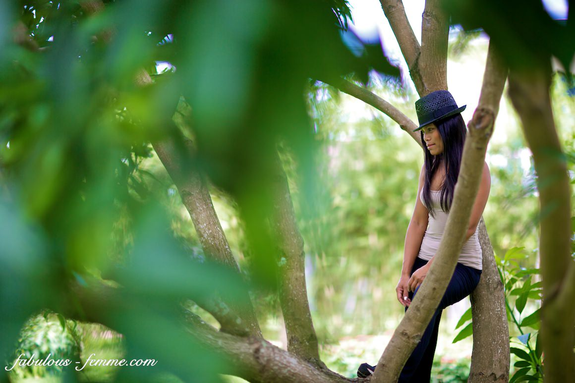 photo shoot in hoi an vietnam - girl climbing a mango tree