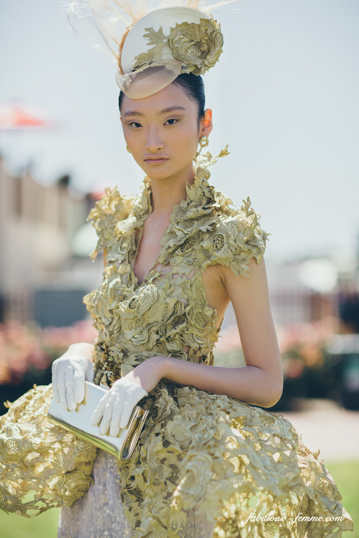 model presenting amazing gold dress at the melbourne cup designer award