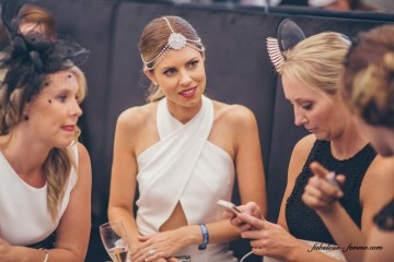 pretty ladies chatting at melbourne cup in tabcorp marquee