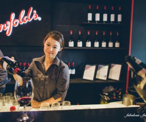 asian girl serving wine at the Melbourne races