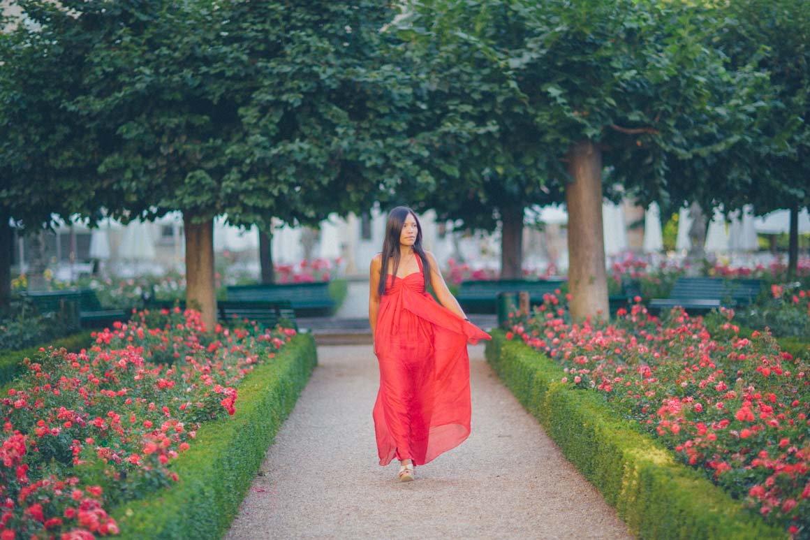 stylish princess in rose garden