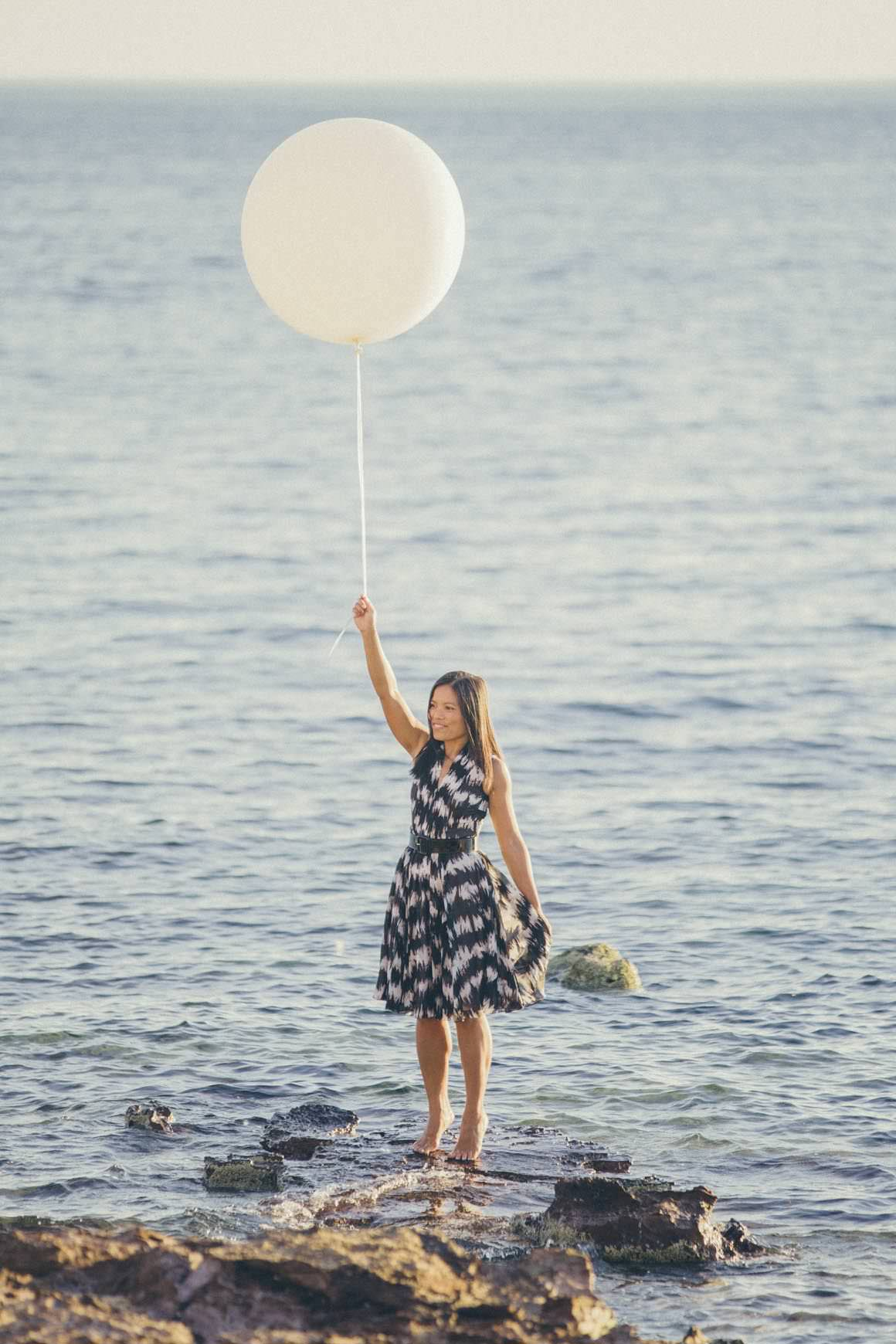 baloon at the beach - girl holding big balloon at the beach - photo prop