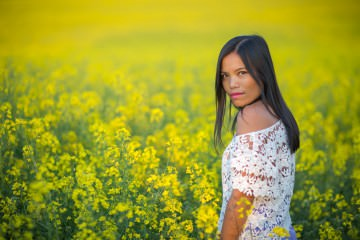 girl in endless yellow flower fields