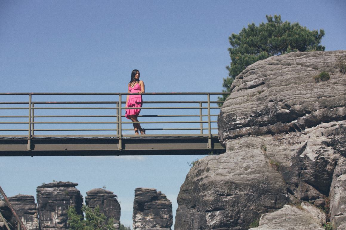 floating bridge - on rocks - girl in pink dress
