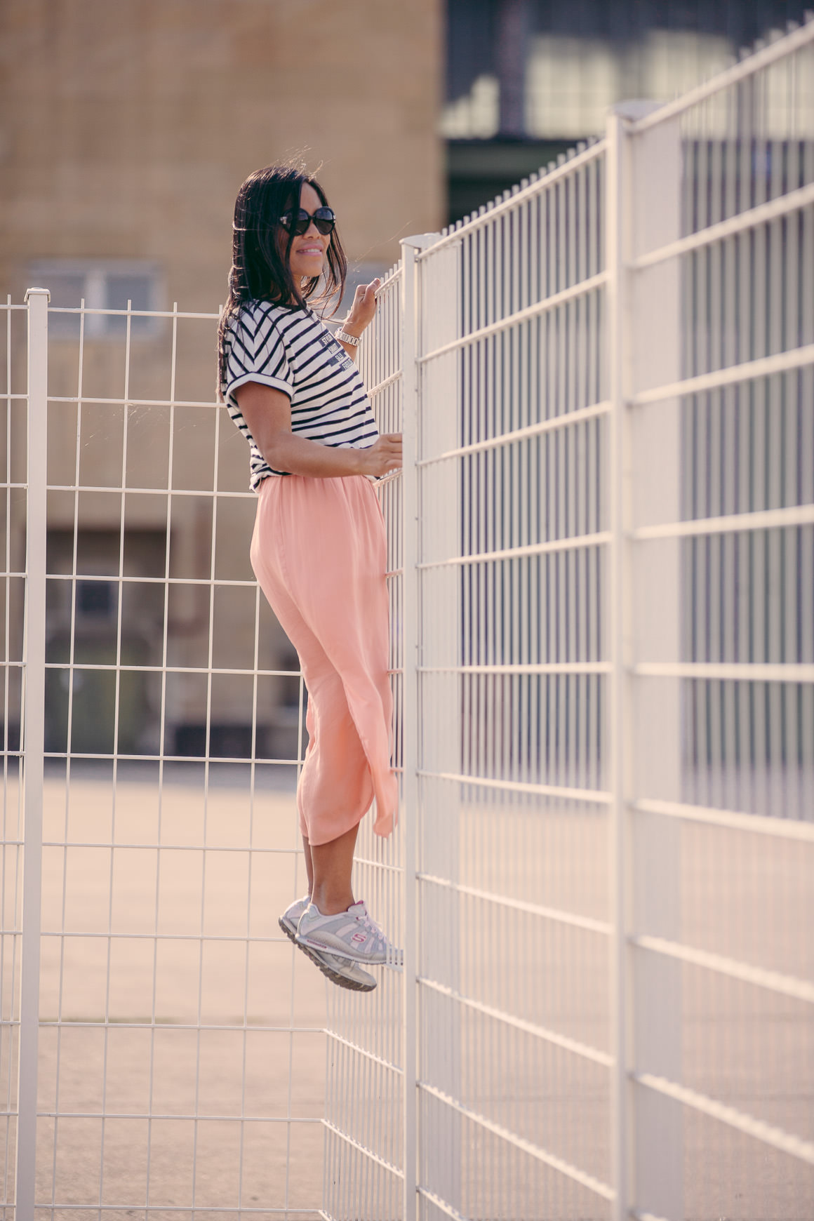 girl on fence - stripes fashion