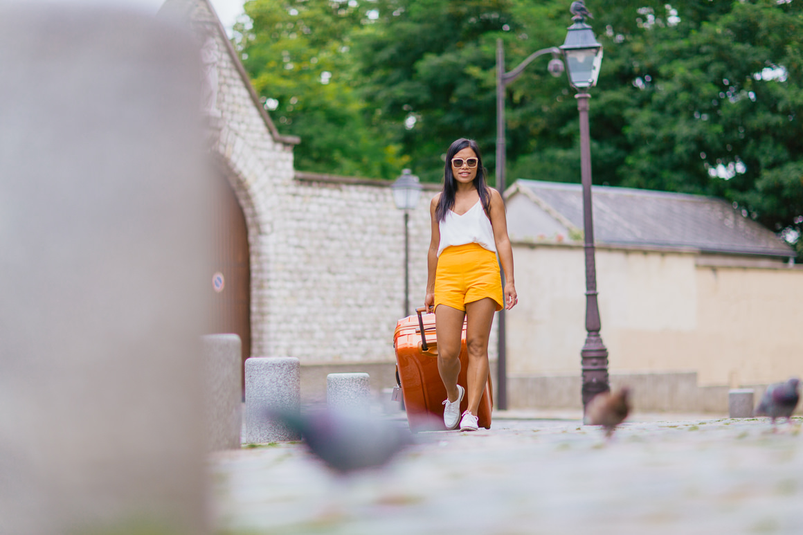 suitcase rolling through paris - orange outfit blog post