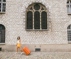 light travels with suitcase