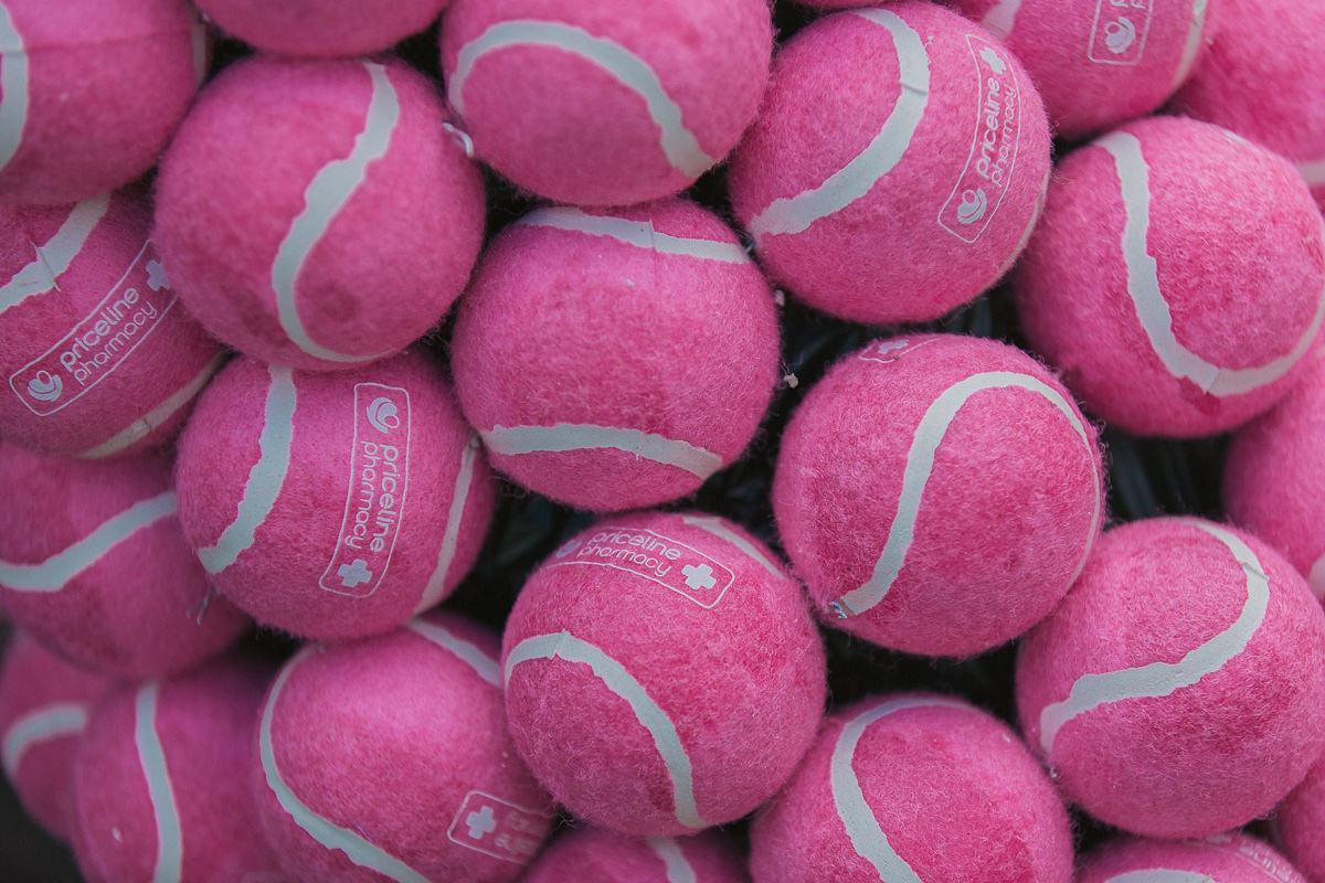 pink tennis balls - priceline sponsor