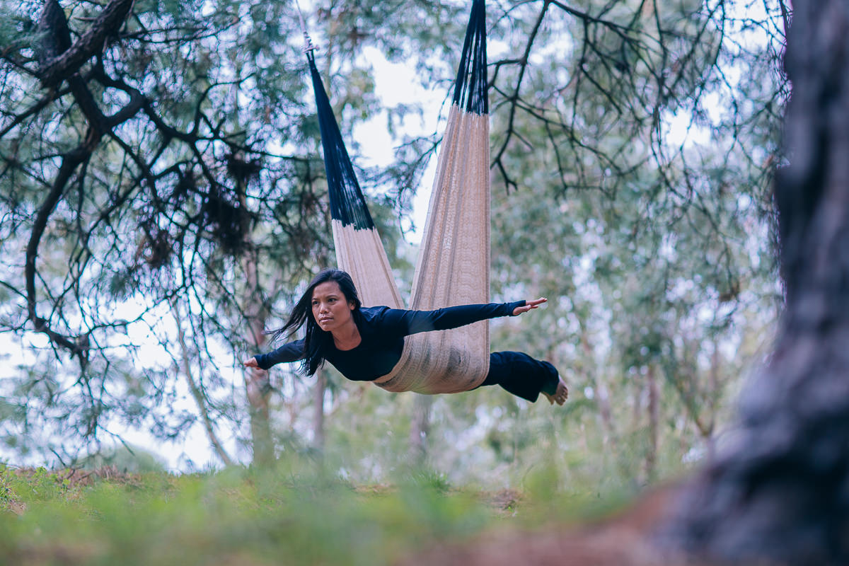 aerial yoga pose outddor - tree plane
