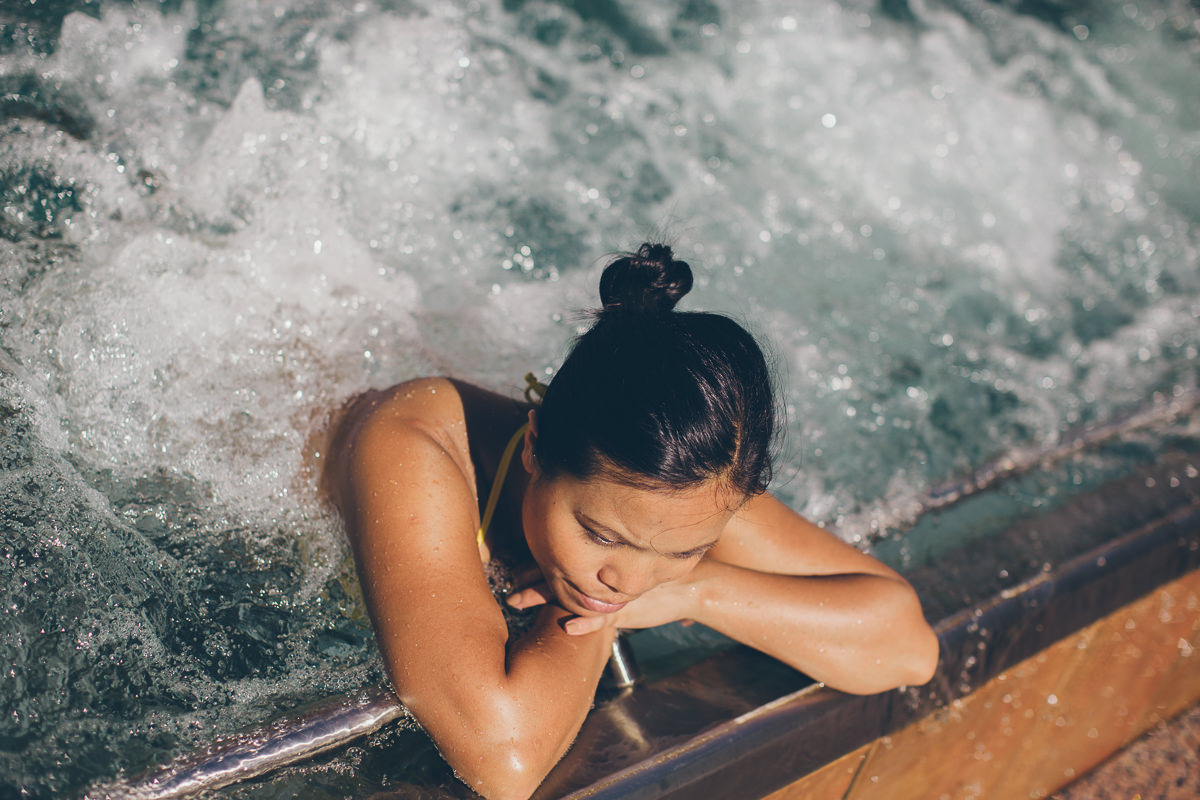 girl in spa pool - luxury resorts