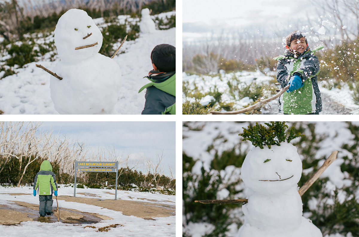 kids building snowman in lake mountain resort  - winter in melbourne