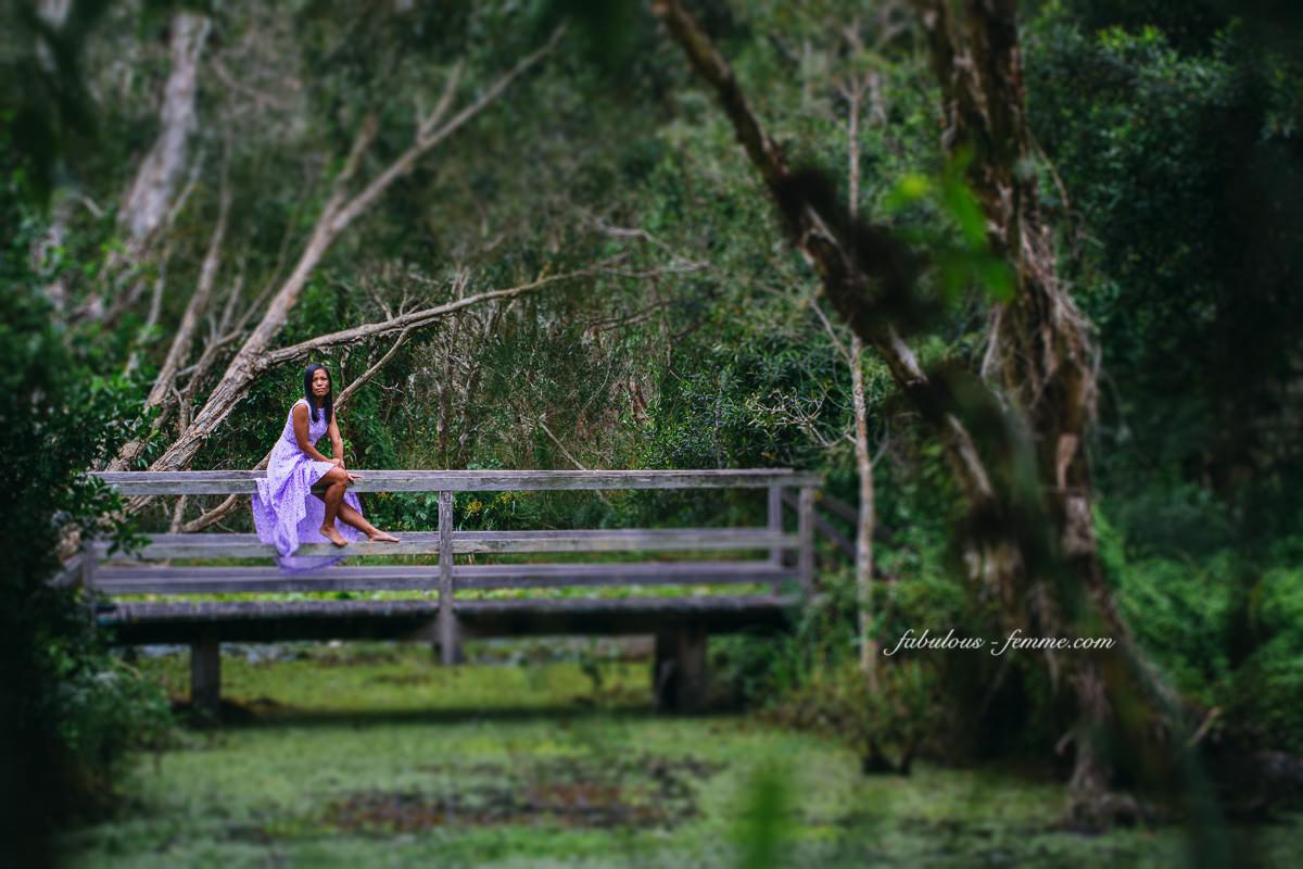 travel byron bay - girl on bridge in jungle in purple dress