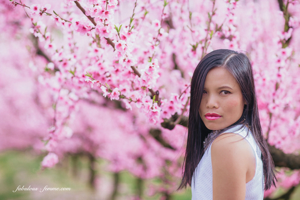 girl with blossom background - pink flowers