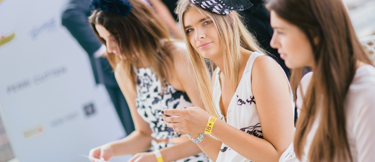 young ladies at the fashions on the field - the next trends