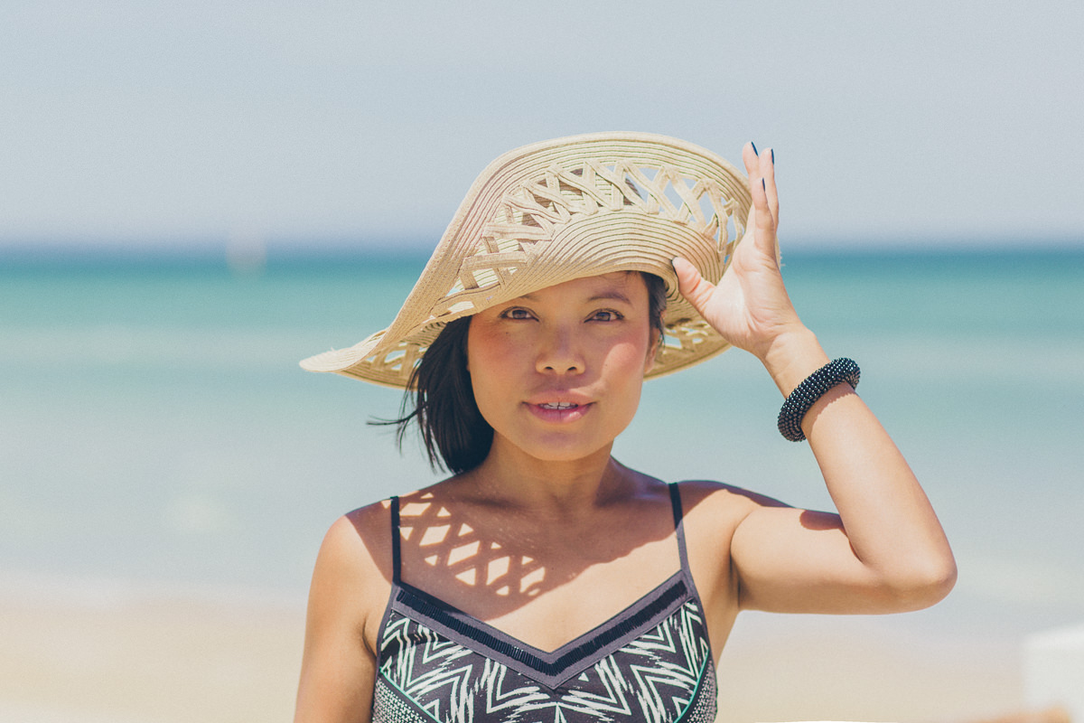straw hat - asian girl - beach - sun