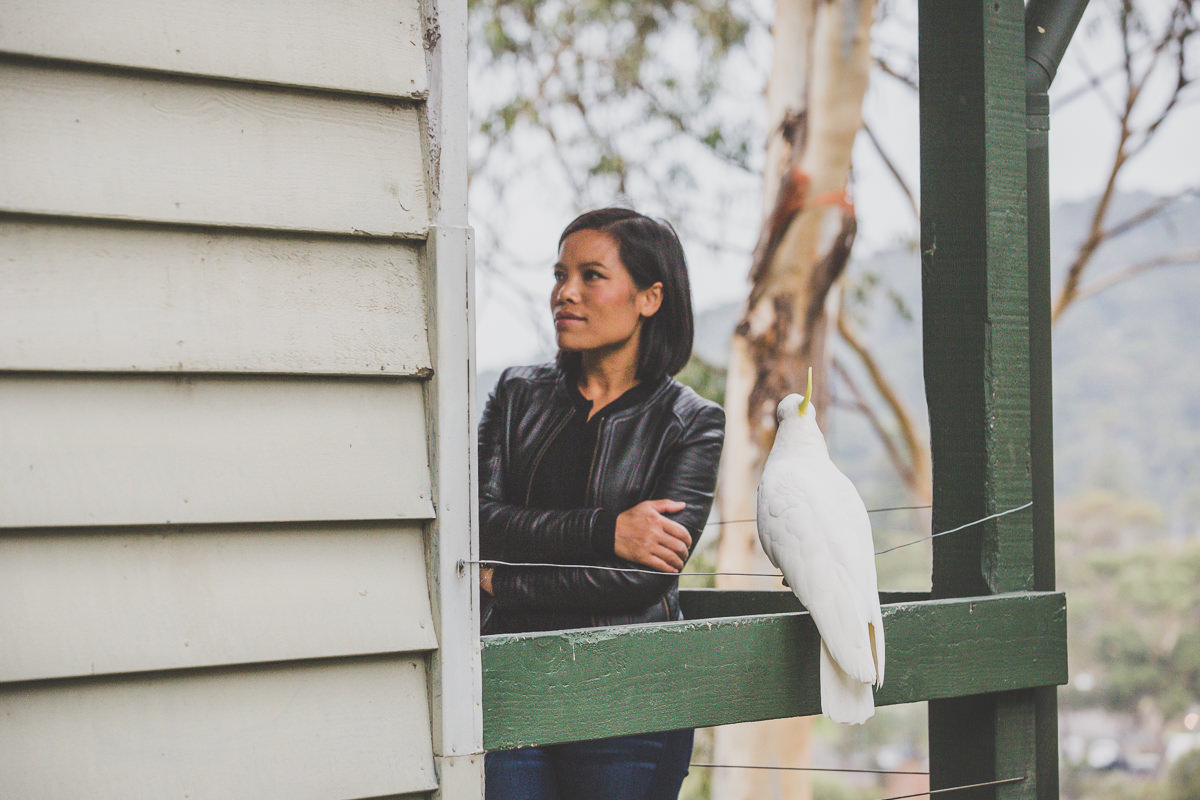standing with cockatoo
