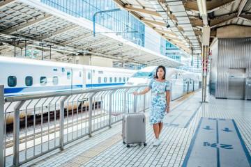 Paklite suitcase travel blogger in Japan on Shinkansen high speed train