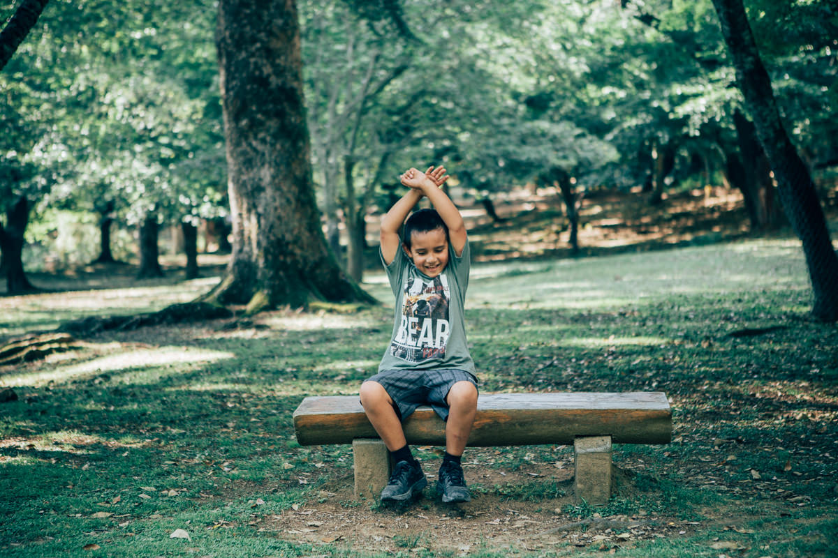 child sitting on bench - children photography