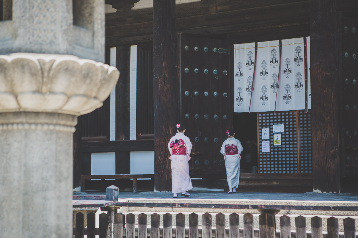 geishas entering temple in japan - travel photos