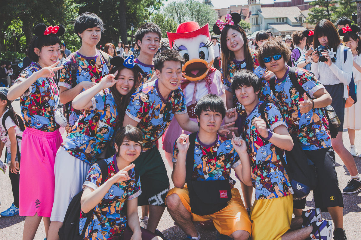 japanese group photograph at disneyland - crazy