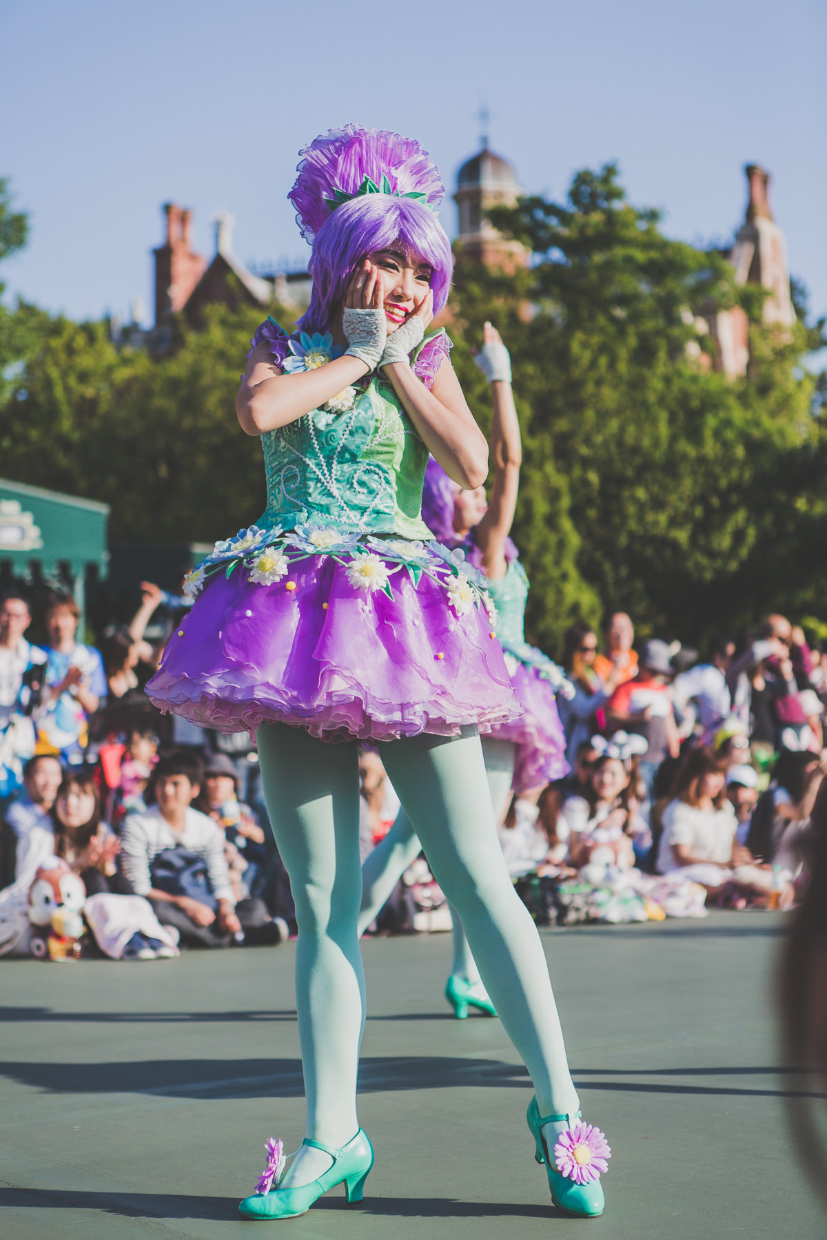 cute japanese girl in colourful outfit at disneyland