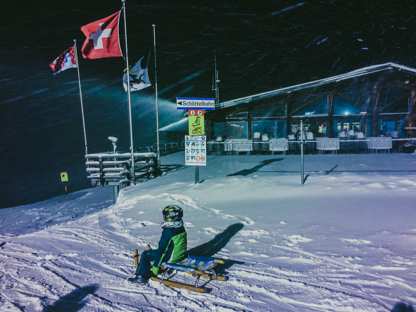 start of the night tobogganing adventure at the rinnerhorn near davos switzerland - adventures with kids