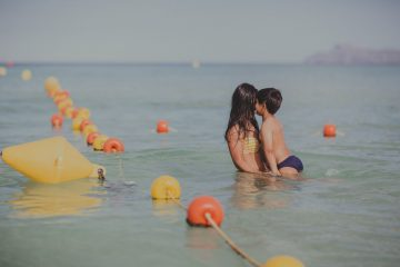 mum and son in ocean - greatful love