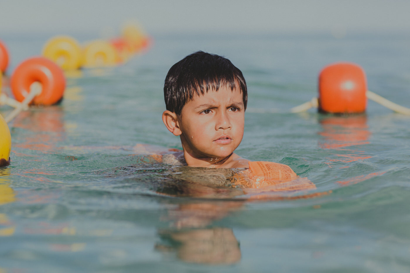 healthy kid swimming