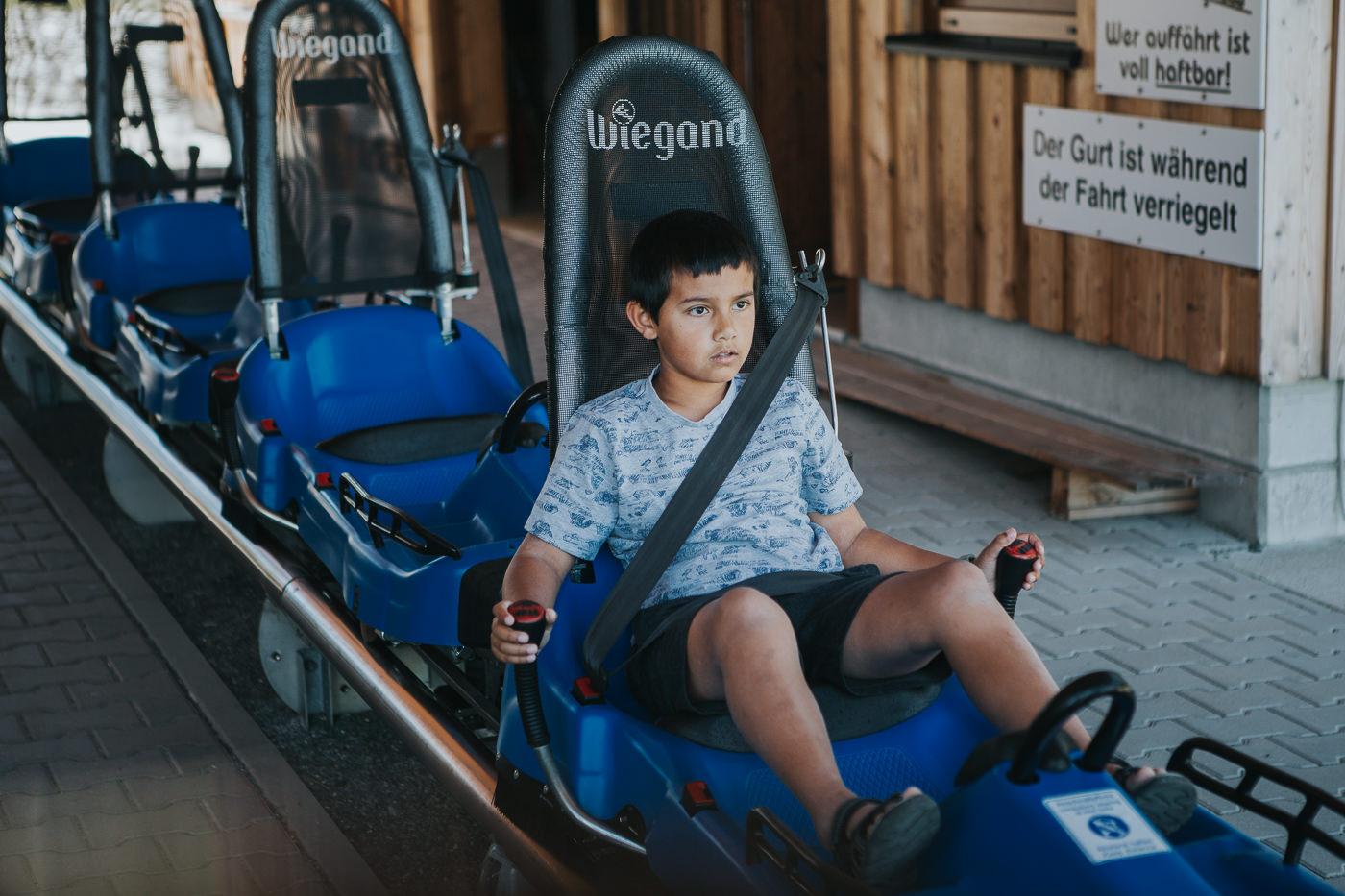 fun rides - boy on sled
