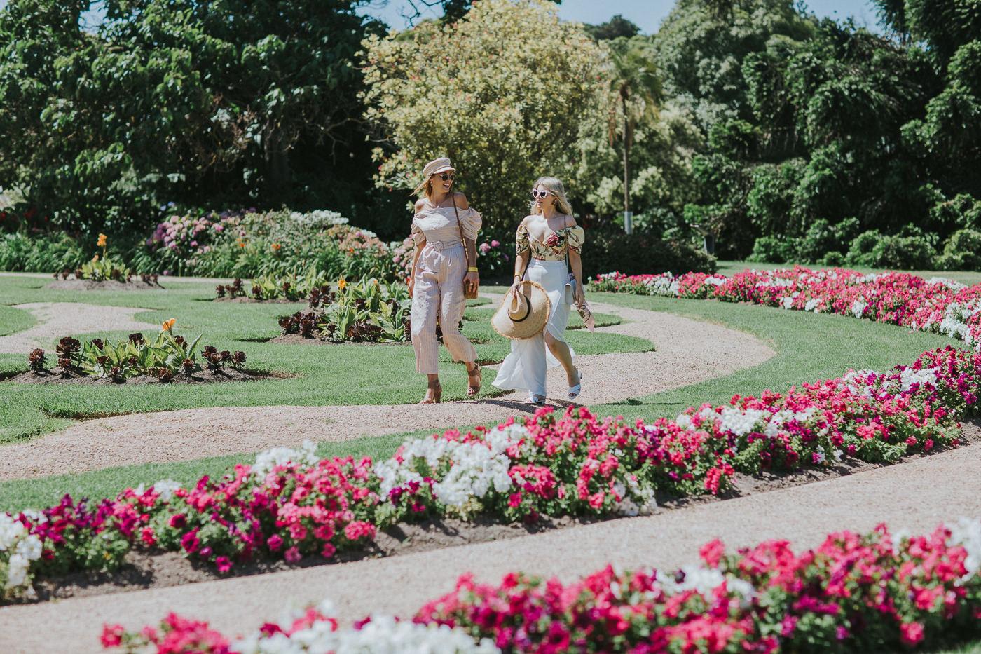 girls walking through gardens at so frenchy so chic