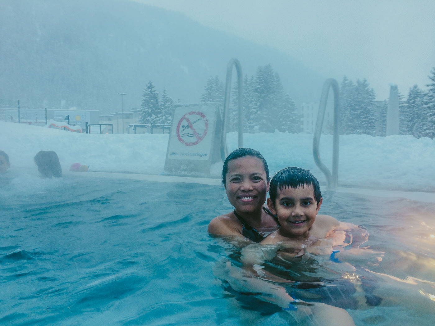 swimming in snow outdoor pool