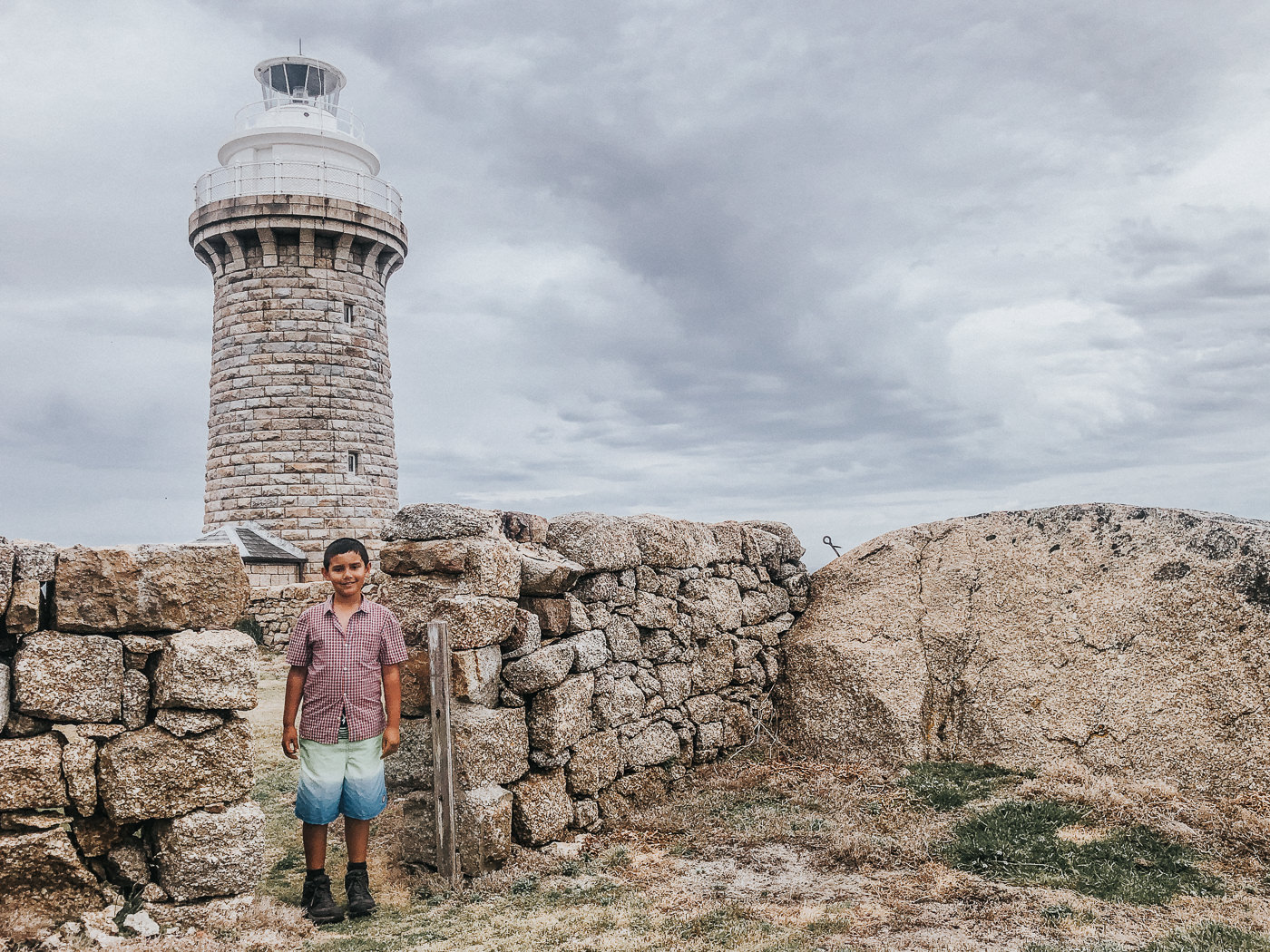child in front of old lightstation - family travel