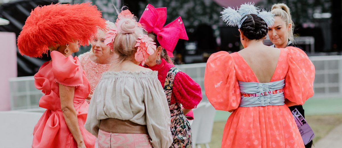 Ladies at the races in colourful outfits