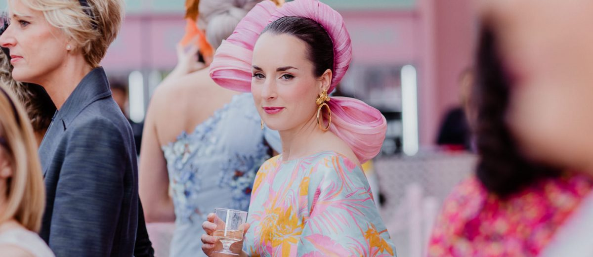 Champagne at the races - lady drinking a glass of champagne at the Melbourne Races