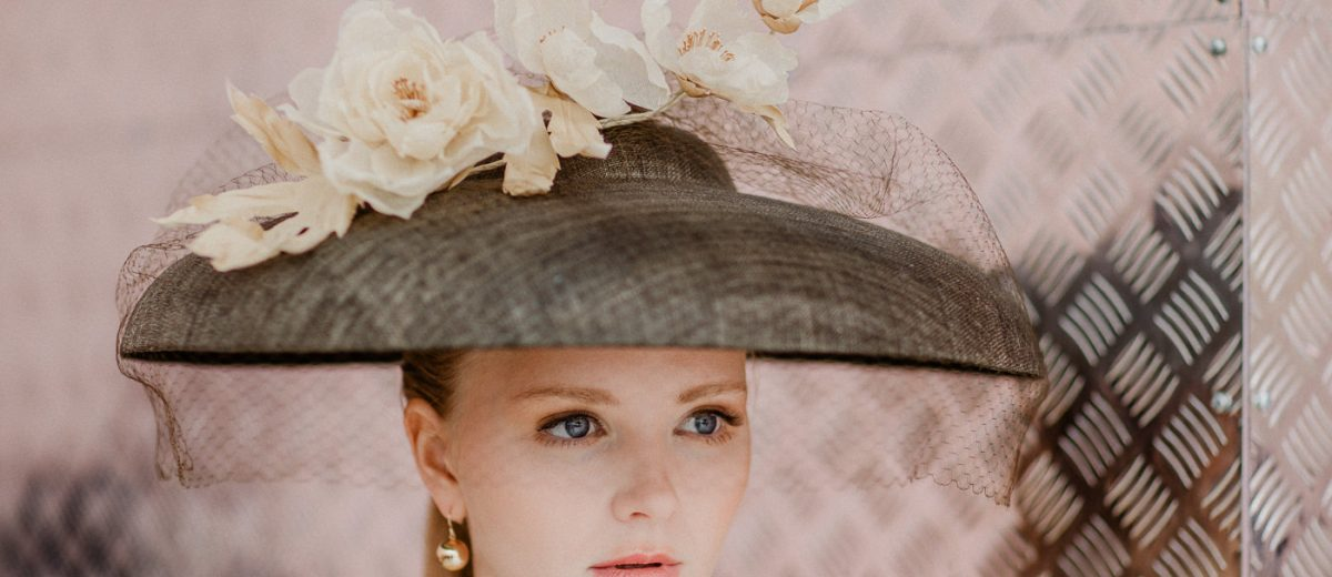 Model wearing racing fashion outfit - Millinery by Anita Marshall Millinery