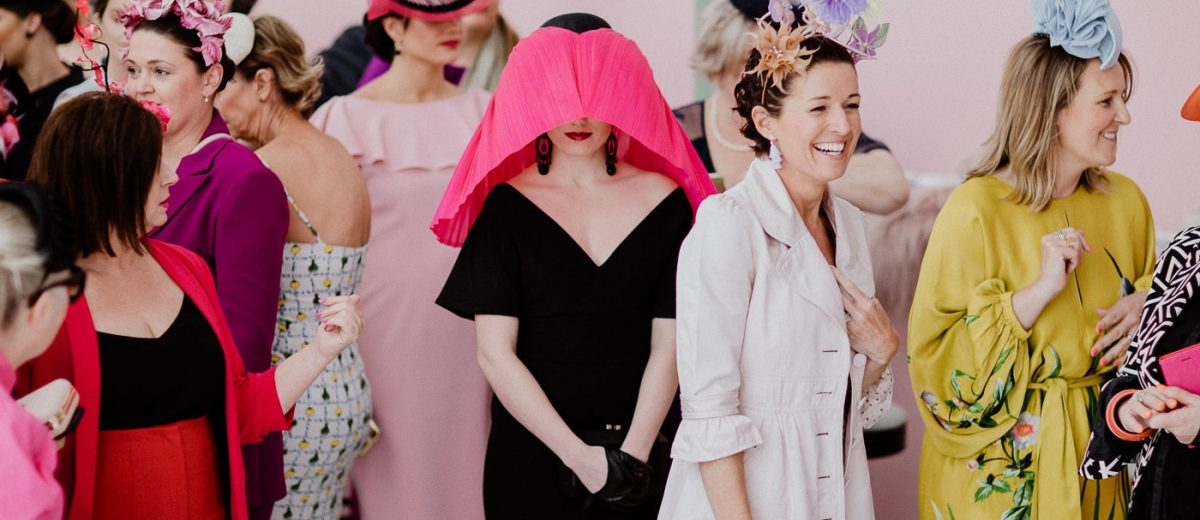 Velvet & Tonic headpiece (3rd PLace at the Myer Millinery Award) within a group of ladies wearing racing fashion - Best candid photo of the Melbourne Spring Racing carnival
