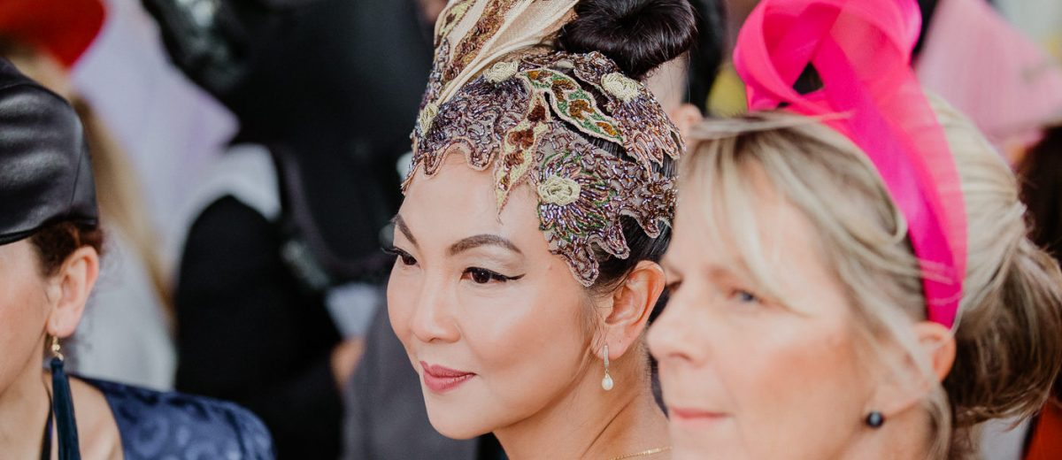 Asian lady wearing impressive millinery at the races - avantgarde