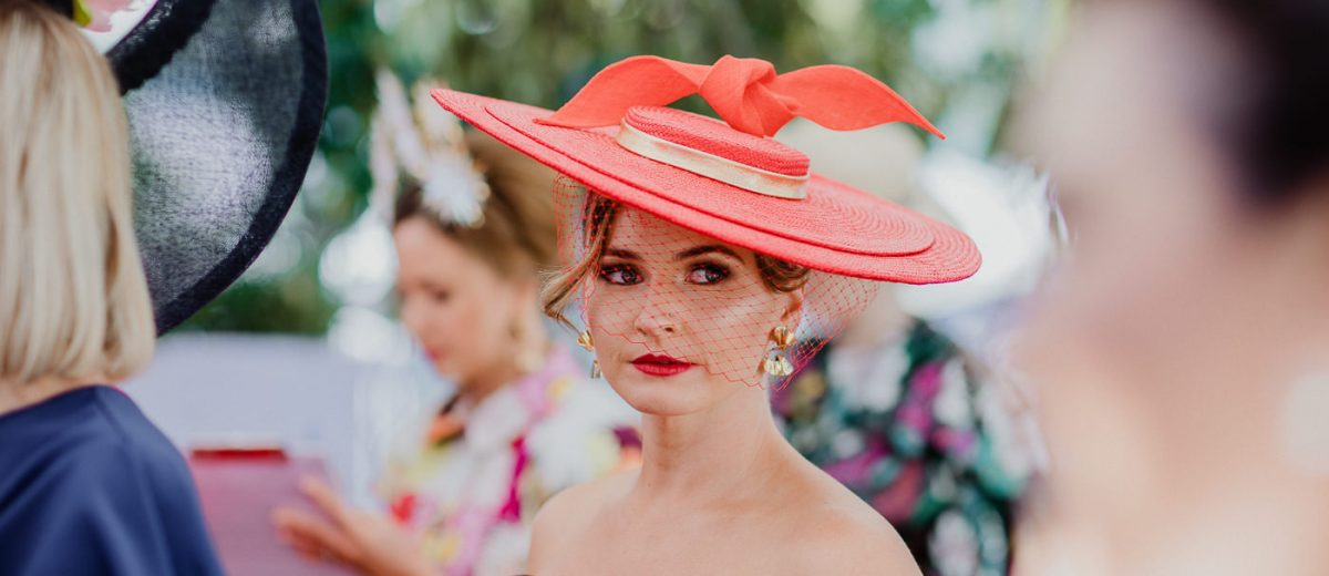 Red boater - millinery and outfits at the races - Best photographs of the Melbourne Cup