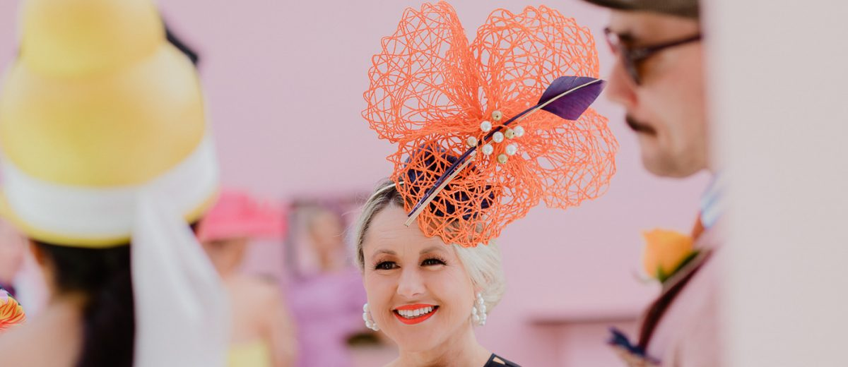 Orange headpiece - world of hats